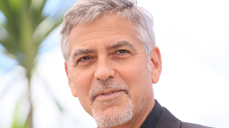 George Clooney looking and posing