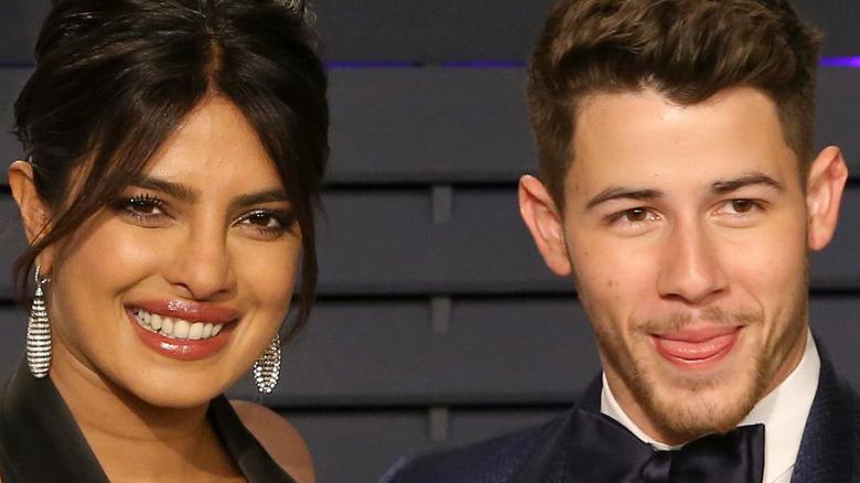 Priyanka Chopra and Nick Jonas smiling at event