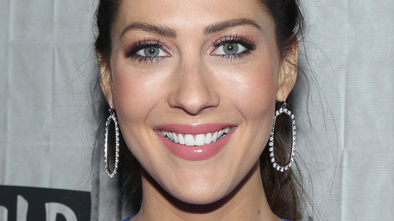 Becca Kufrin with wide smile