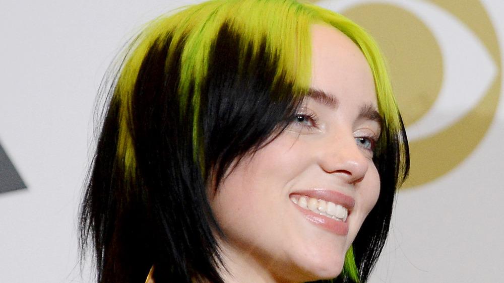 Billie Eilish holds her awards at the 2020 Grammys