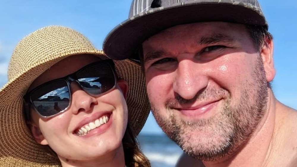 Kirlyam and Alan Cox take a selfie together on the beach