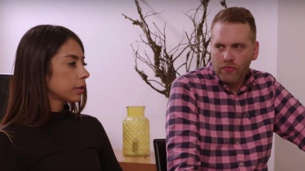 Tim Clarkson and Melyza Zeta have a tense conversation
