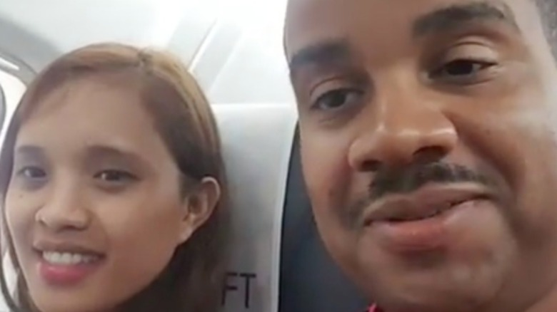 Hazel Cagalitan and Tarik Myers speak to their camera on an airplane