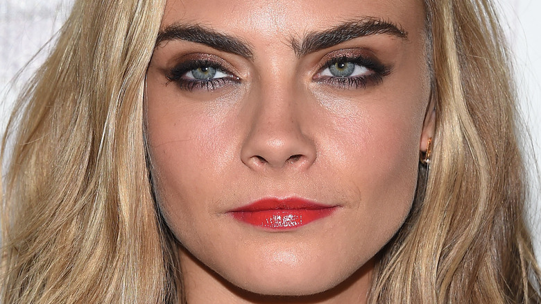 Cara Delevingne with a neutral expression