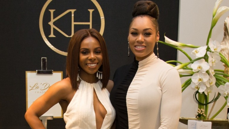 Candiace Dillard Bassett and Monique Samuels attend La'Dame Fragrance Pop-up