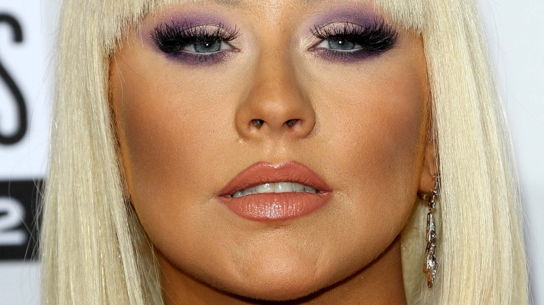 Christina Aguilera with a neutral expression