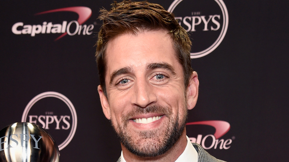 Aaron Rodgers spring at an award ceremony