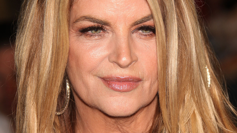 Kirstie Alley looking to the side with slight smile