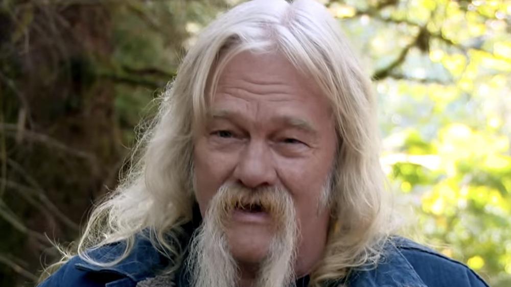 Billy Brown, sitting outside, talking, long white hair, long beard