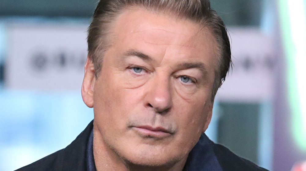 Alec Baldwin looks serious during an interview