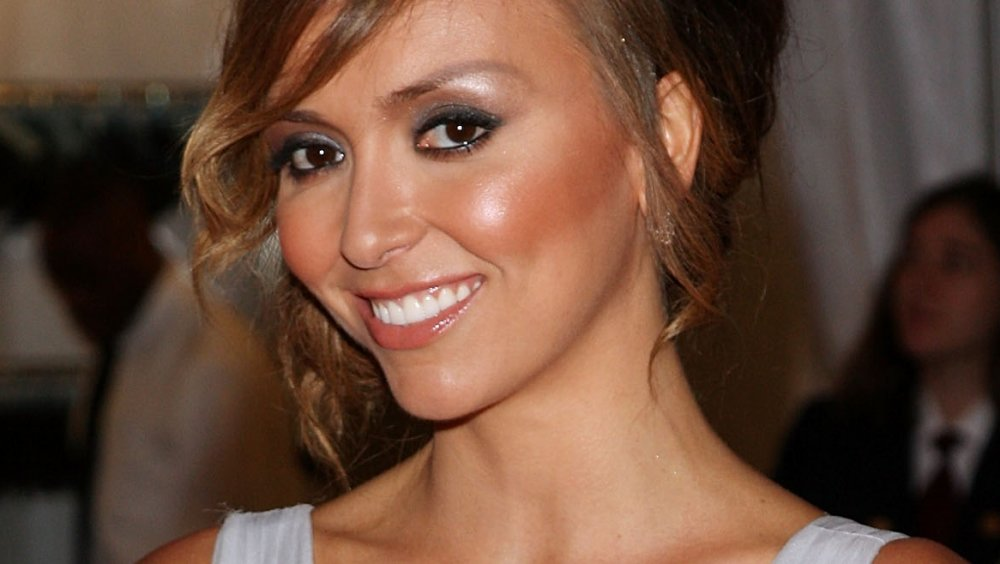 Giuliana Rancic smiling on the red carpet in 2008