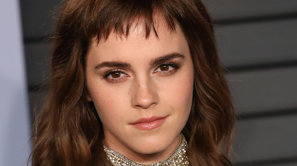 Emma Watson posing on the red carpet at the British Fashion Awards