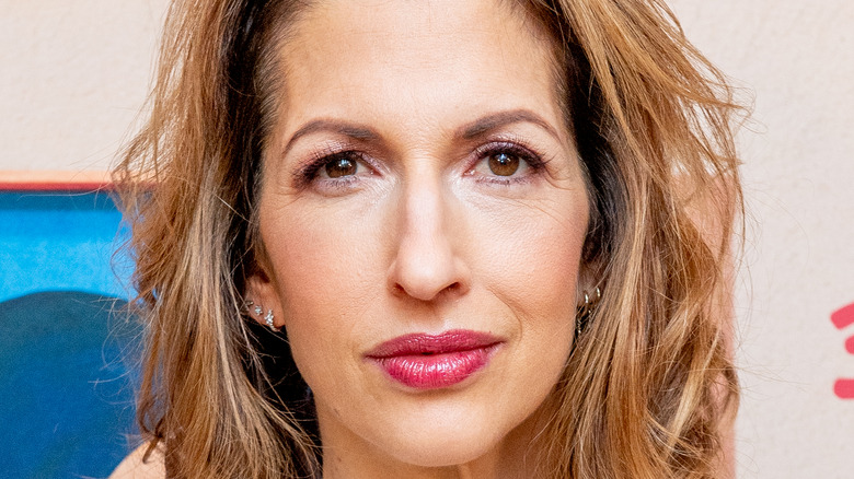 Alysia Reiner smiling on the red carpet