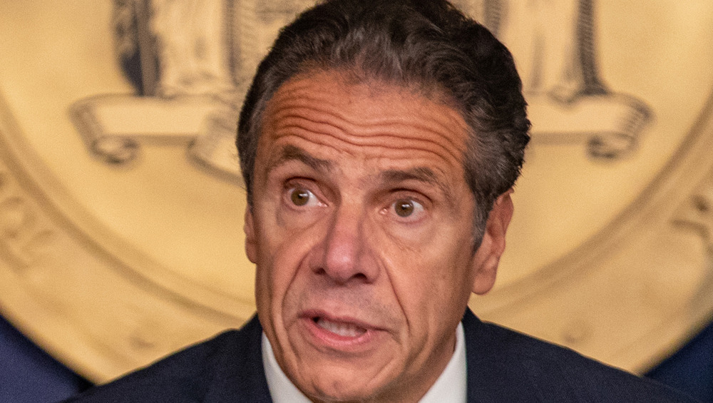 Andrew Cuomo looks animated while speaking to reporters at a call