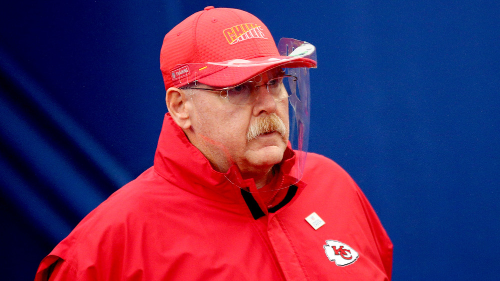 Andy Reid wearing a clear face shield on the field