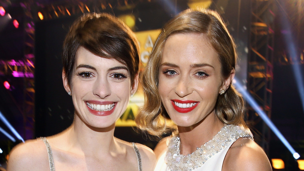 Anne Hathaway and Emily Blunt smiling
