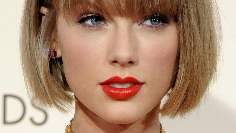 Taylor Swift smiling red lipstick