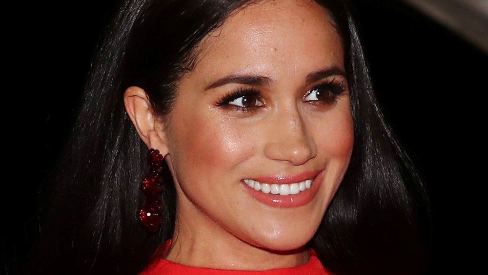 Meghan Markle smiling at an event
