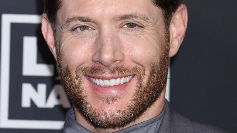 Jensen Ackles smiling on the red carpet