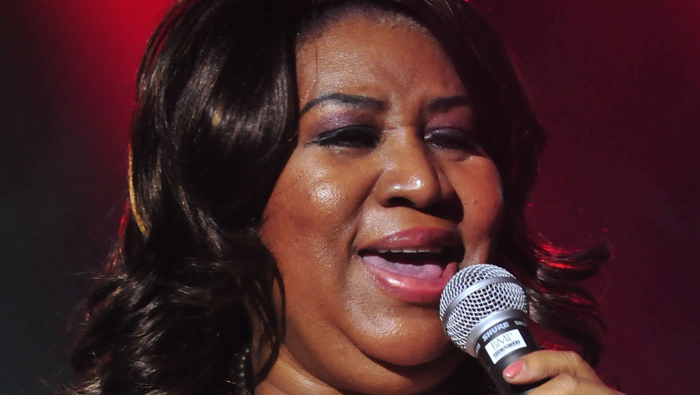Aretha Franklin singing into a microphone