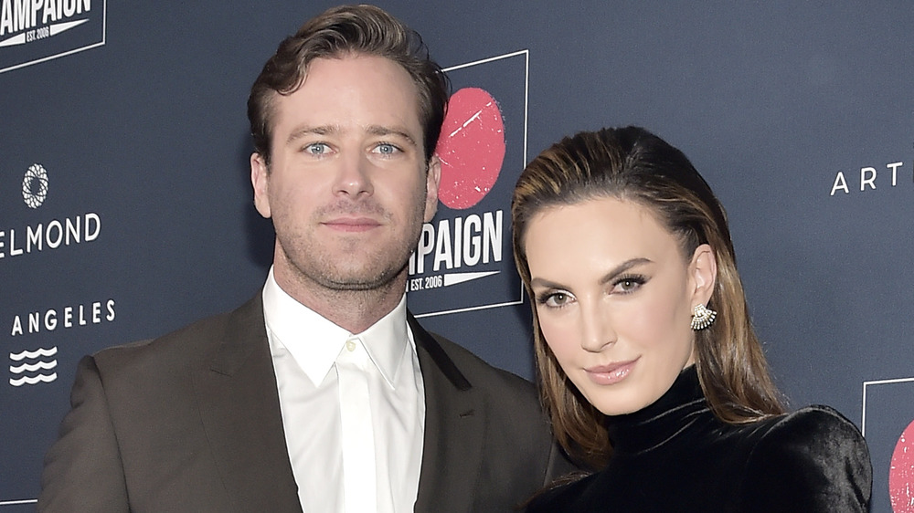 Armie Hammer and Elizabeth Chambers posing together at an event