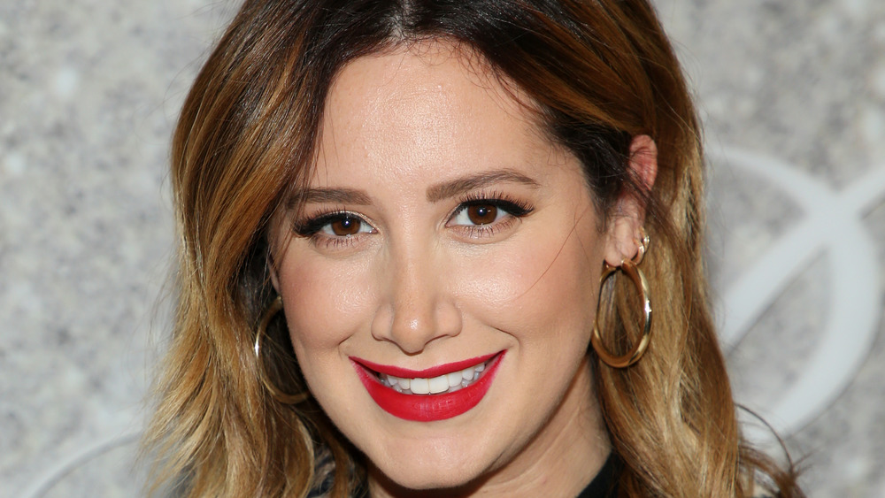 Ashley Tisdale poses in red lipstick
