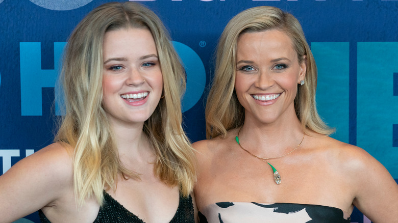 Ava Phillippe and Reese Witherspoon laughing