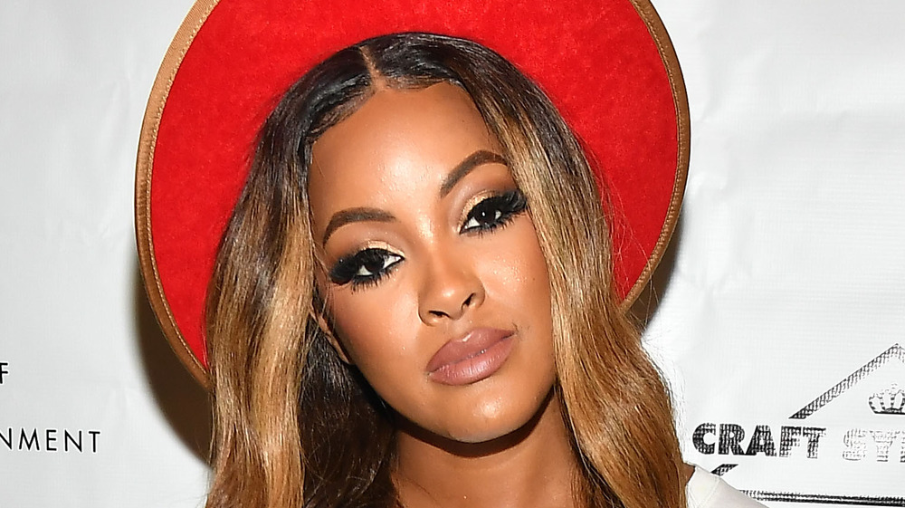 Malaysia Pargo wears a red hat while posing at an event