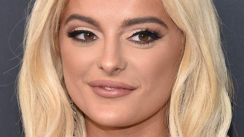 Bebe Rexha smiling at an event