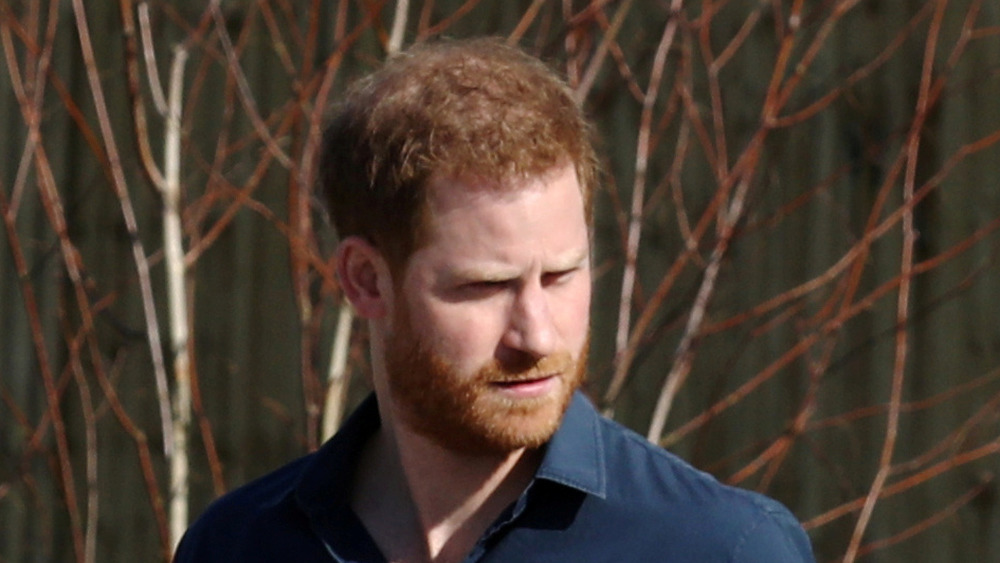 Prince Harry outside and walking