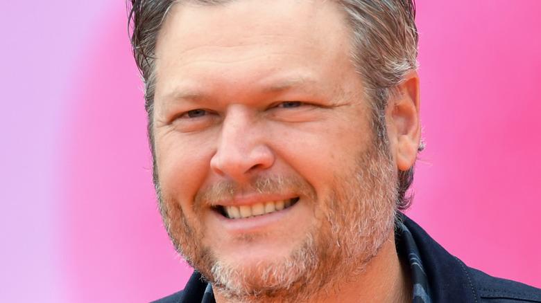 Blake Shelton smiling on the red carpet