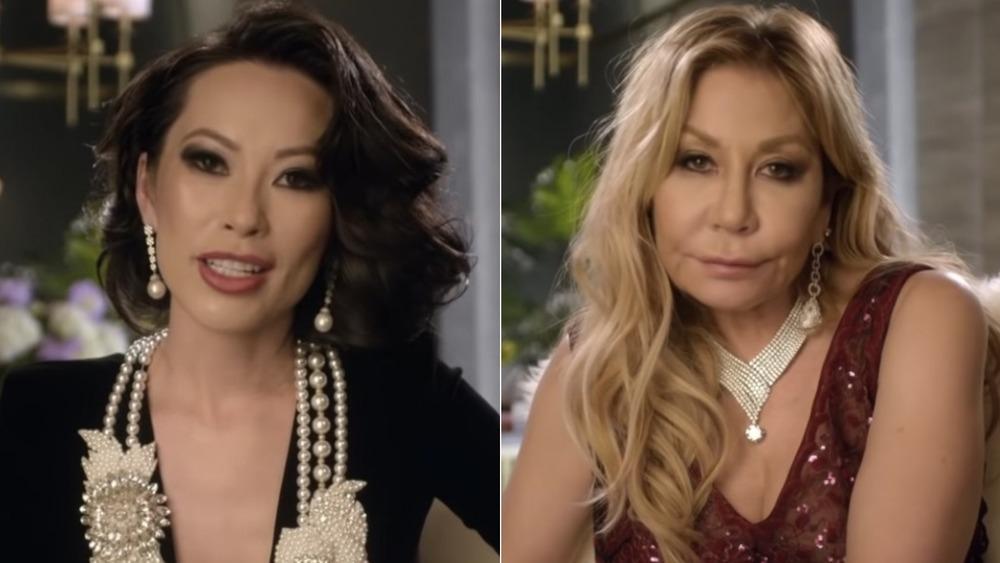 Christine Chiu, talking, hair curled, black shirt, pearls; Anna Shay, not smiling, sitting down, hair down, brown dress