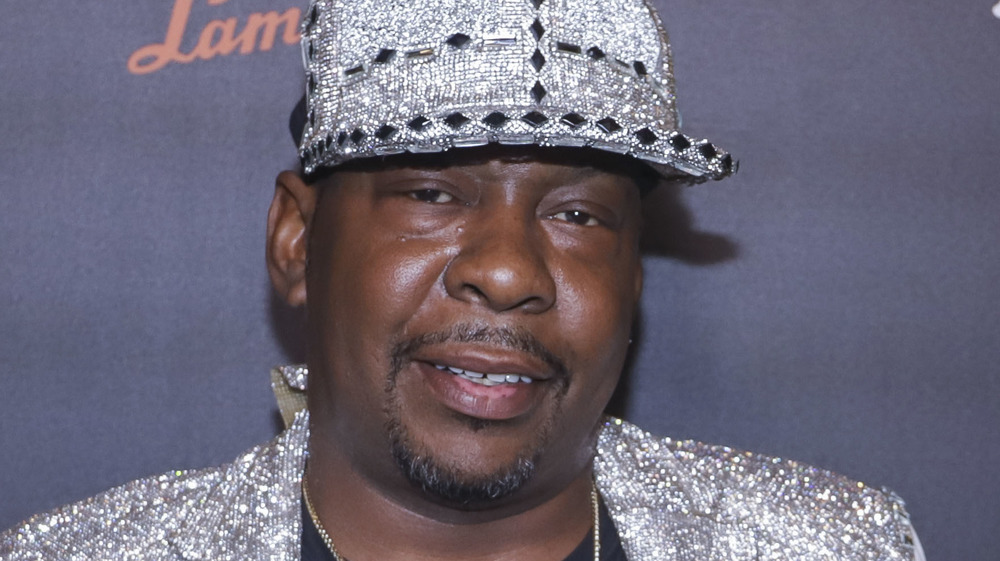 Bobby Brown wearing a silver cap on the red carpet