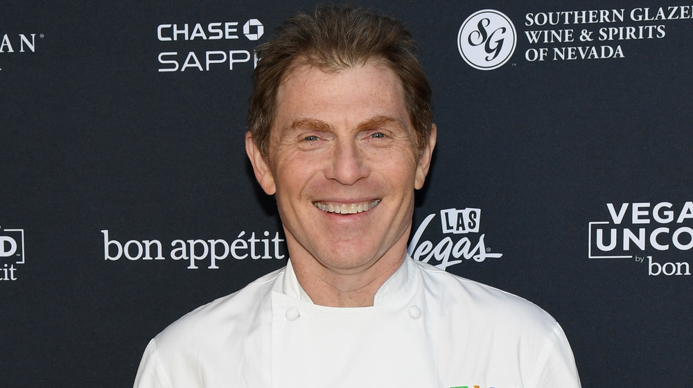 Bobby Flay wearing chef's uniform, smiling