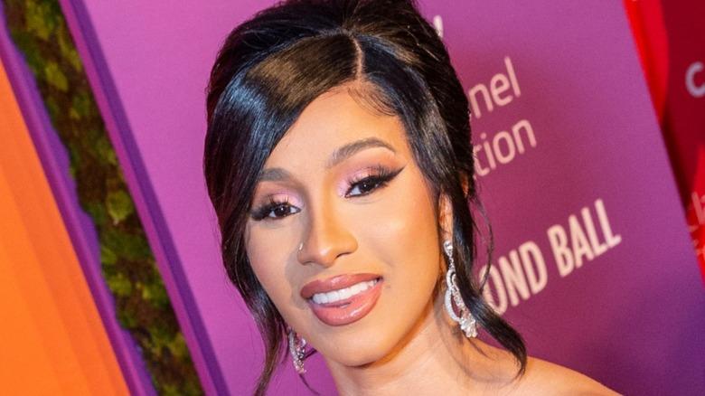 Cardi B smiling and wearing pink eyeshadow