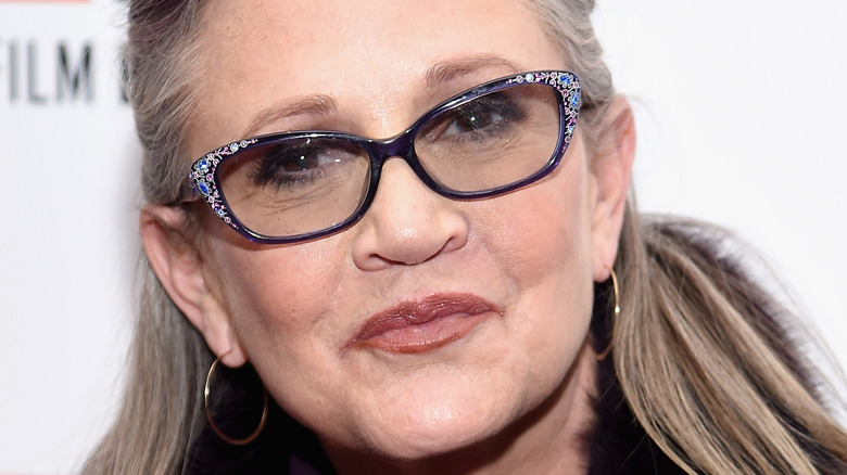 Carrie Fisher smiles on red carpet