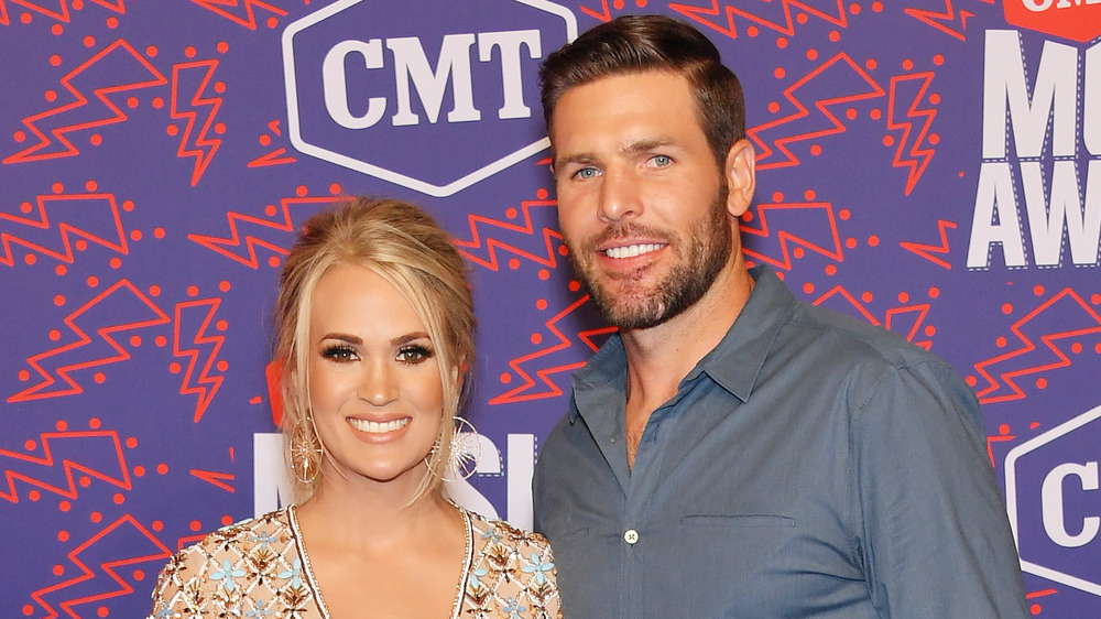 Carrie Underwood and Mike Fisher smiling