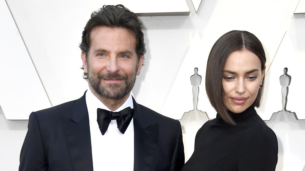 Bradley Cooper and Irina Shayk looking irritated