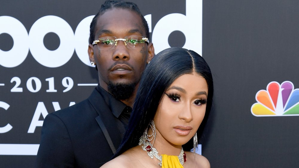 Offset standing behind Cardi B with his arms around her