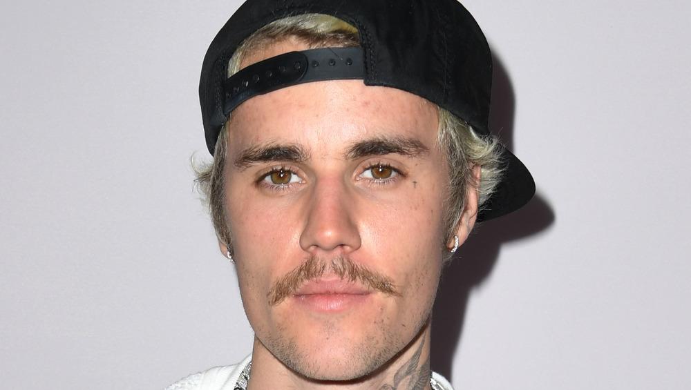 Justin Bieber wearing black cap
