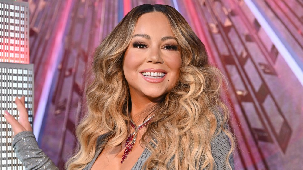 Mariah Carey smiling with very curly hair