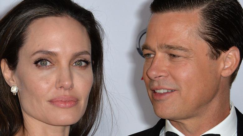 Brad Pitt looking at Angelina Jolie