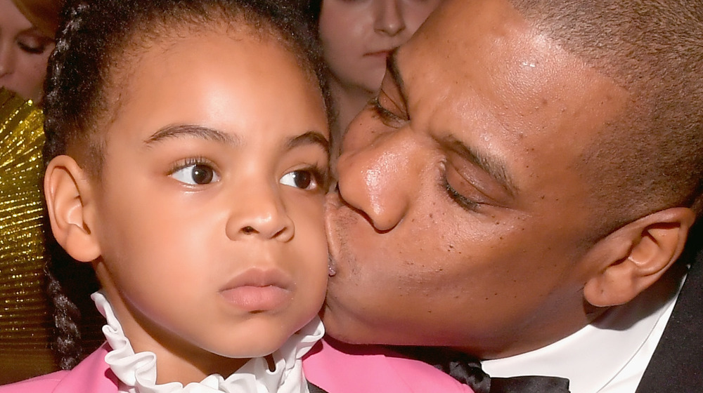 Jay Z kissing Blue Ivy Carter on cheek
