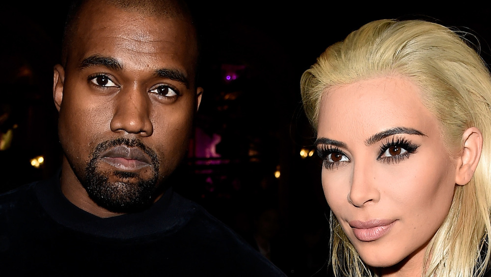 Kanye West and Kim Kardashian attending an event