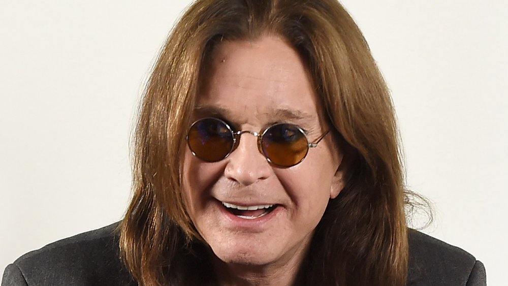 Ozzy Osbourne with dark tinted circle glasses