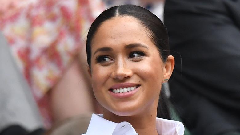 Meghan Markle smiling at Wimbledon