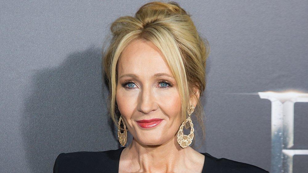 J.K. Rowling with long gold earrings