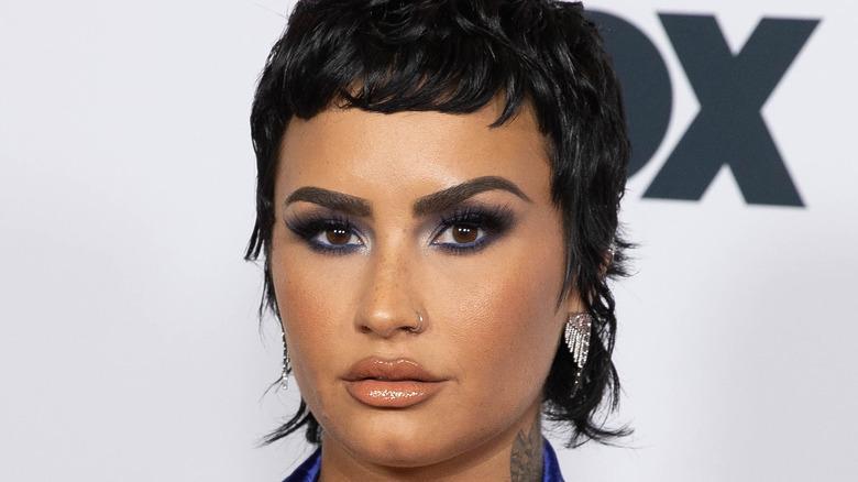 Demi Lovato looking at camera