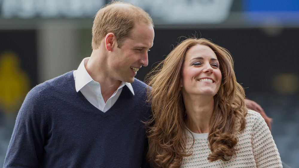 Prince William and Kate Middleton walking arm in arm