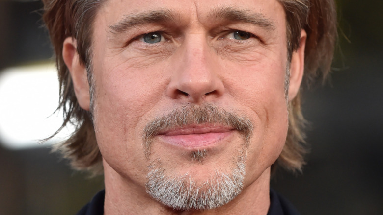 Brad Pitt with a neutral expression
